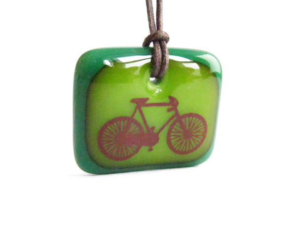 Road bike pendant necklace in green.