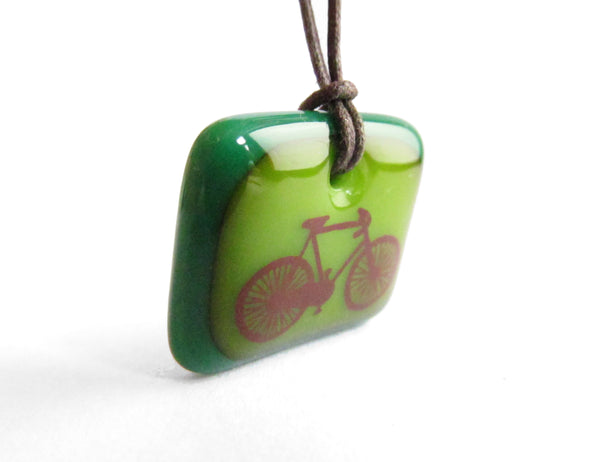 Road bike necklace in aqua blue a red colours.
