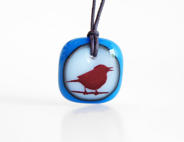 Songbird necklace in royal blue and milk white glass.