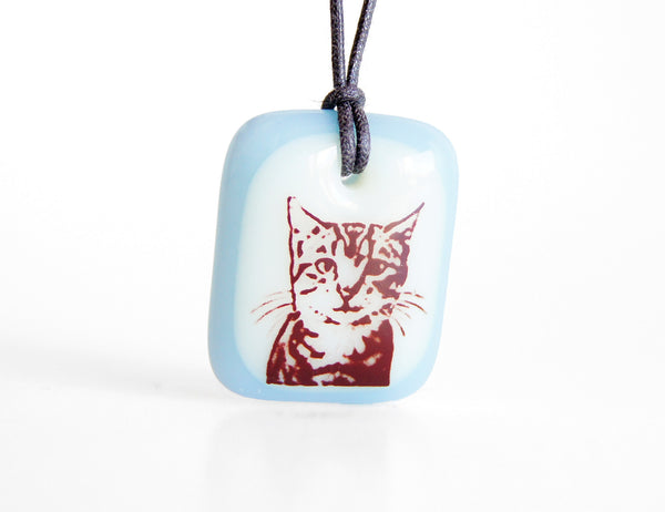 Tabby cat pendant necklace in light blue.