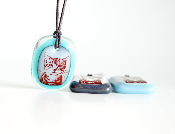 Tabby cat necklace in turquoise blue.