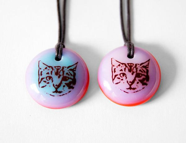 Cute Cat Necklace in lavender and red.