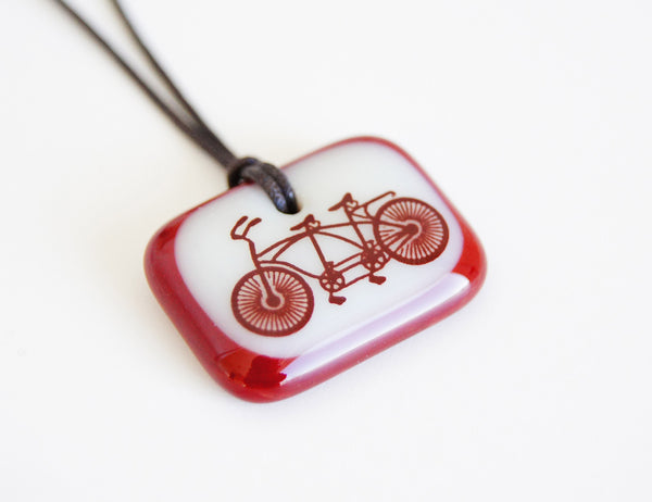 Cream and dark red glass tandem bicycle pendant