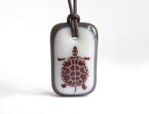 Turtle necklace in charcoal grey and white.
