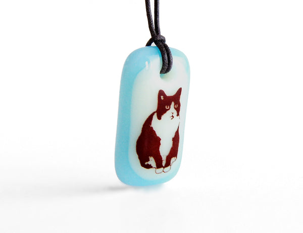 Sweet tuxedo cat necklace handmade in cream and ice blue by Leila Cools