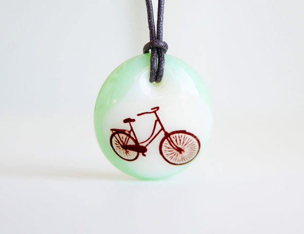 Bicycle pendant necklace in mint green.