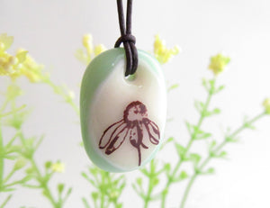 Wildflower necklace in pale green.