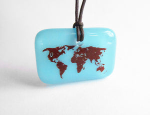 Blue map of the world pendant on cord necklace.