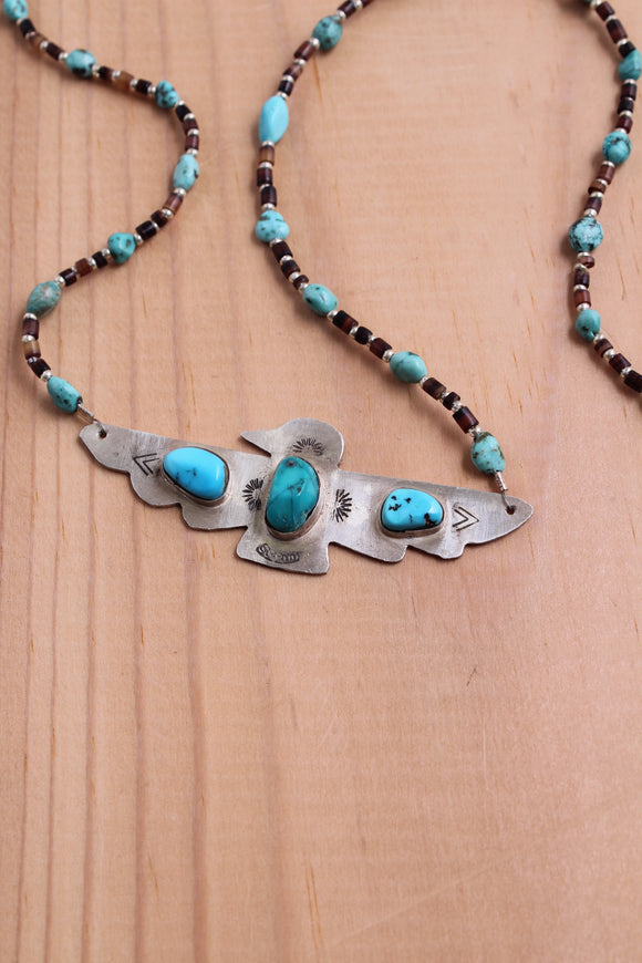 thunderbird bird power boho bohemian pluma feather stamped beaded shell Silver sterling silver moon ring necklace handmade crystal point turquoise made beads naja native American jewelry healing power labradorite pendant