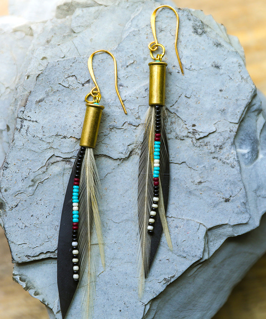 Turquoise, black, rusty red and ivory seed beads, recycled bike tire, delicate rooster feathers, 22 bronze bullet shell, 22K gold hook, bohemian, mountain, skier, river, biker, climber, unique, Rocky Mountains, Jackson Hole, Steamboat, Colorado, handmade, handcrafted, locally sourced, boho, gypsy, earthy, yoga, flirty, gift for her, girlfriend, bridesmaid gift, Nadia Burton, Laramie designer, Wyoming, yogi earrings, Targhee earrings