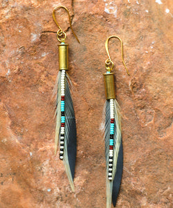 Seed beads, recycled bike tire, feathers, 22 bronze bullet shell, 22Kt gold hook, bohemian, mountain girl earring, skier earrings, river girl earrings, mountain biker earrings, climber earrings, Rocky Mountain earrings, Jackson Hole earrings, Steamboat earrings, Colorado earrings, handmade, handcrafted, locally sourced, boho, gypsy, earthy, yoga, flirty, gift for her, girlfriend, bridesmaid gift, Nadia Burton, Laramie designer, Wyoming, yogi earrings, Targhee earrings