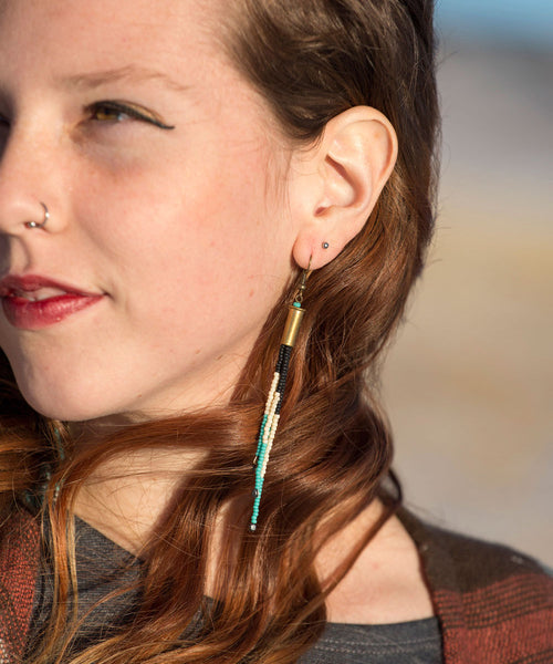 Turquoise dangle earring, traditional Native American style seed beading pairing turquoise, black and ivory beads with a .22 bronze bullet shell and topped with a 22K gold filled hook, mountain girl, bohemian style, perfect gift for girlfriend, classy, sexy, rustic, western