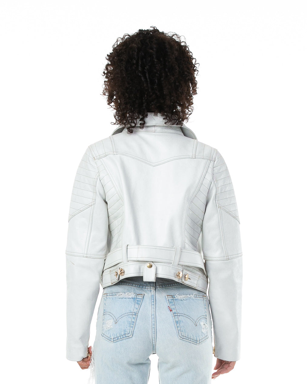Backside of female model wearing Prince leather jacket