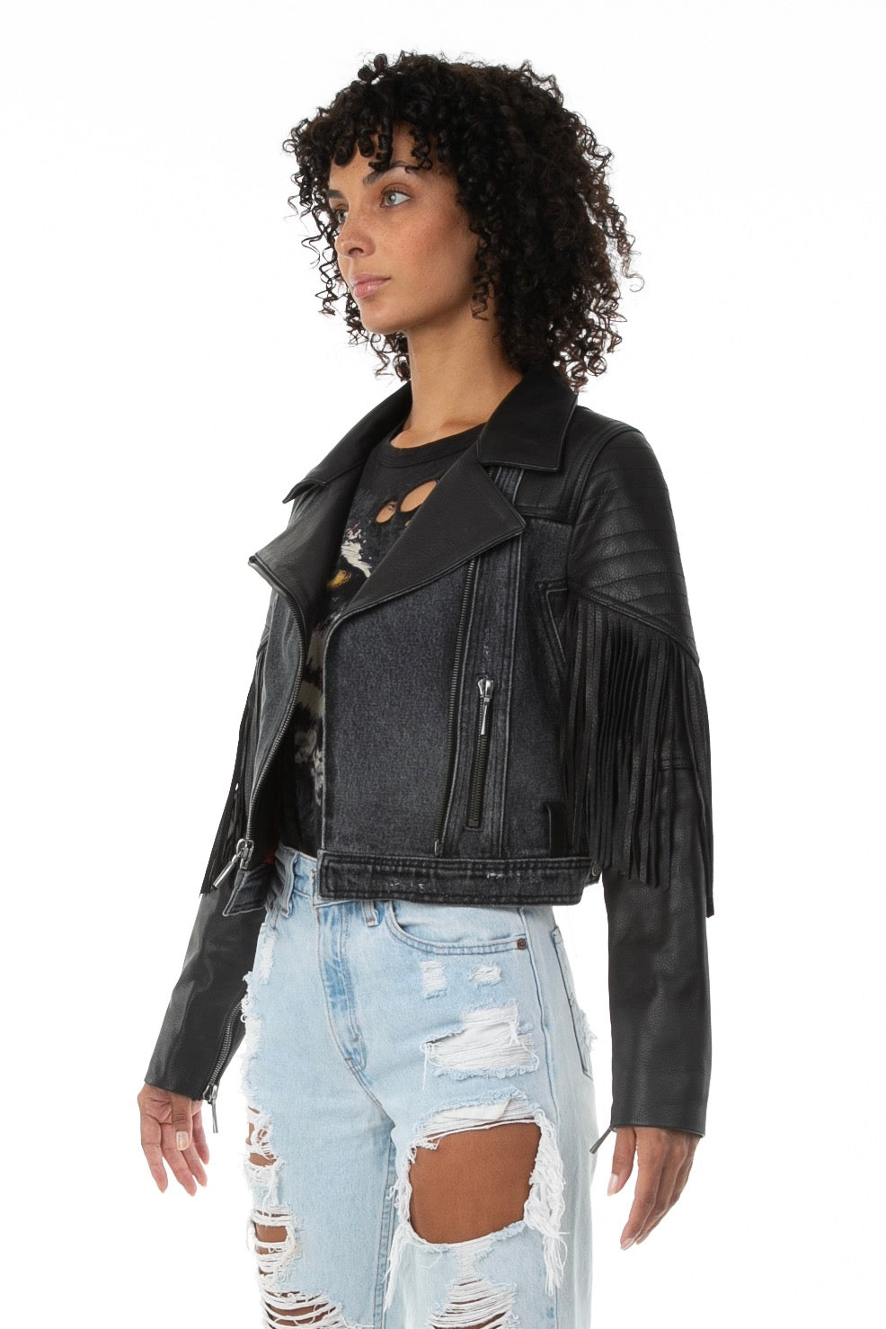 Side of female model wearing La Matadora leather jacket