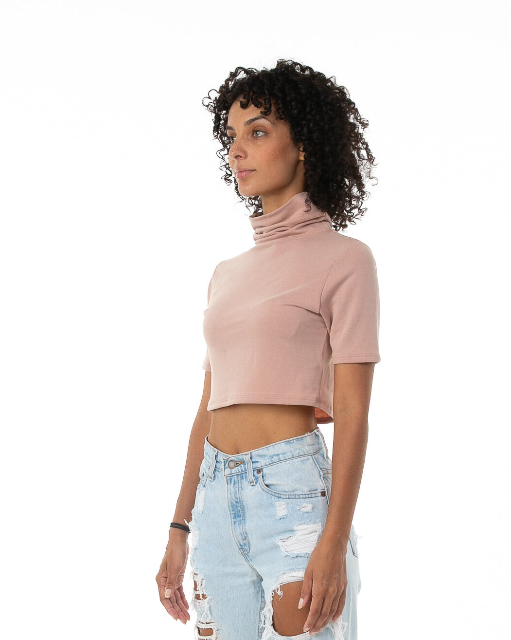 Side of female model wearing Mock Crop in Mauve