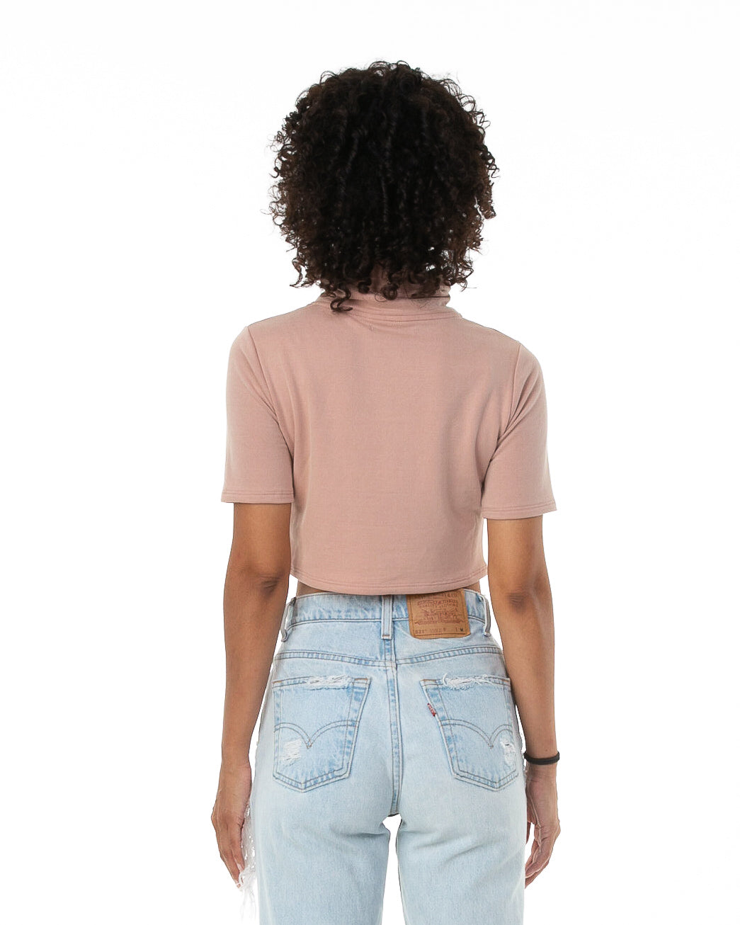 Back of female model wearing Mock Crop in Mauve
