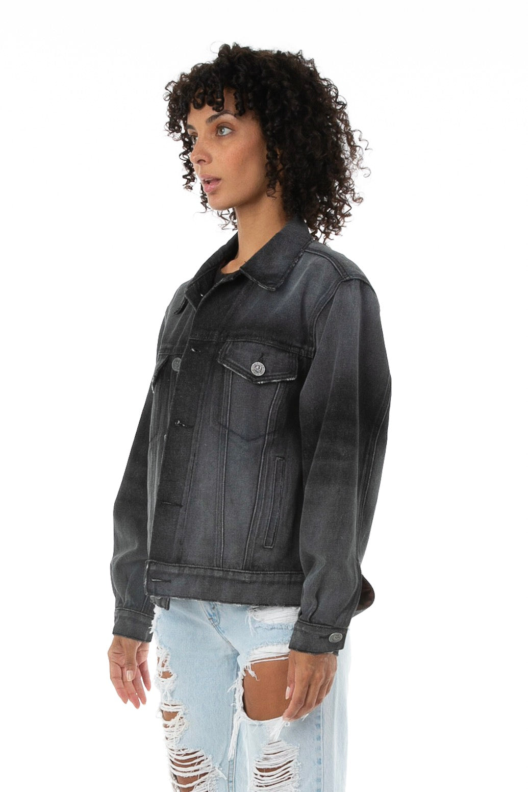 Side of Female model wearing Black Truffle Denim jacket