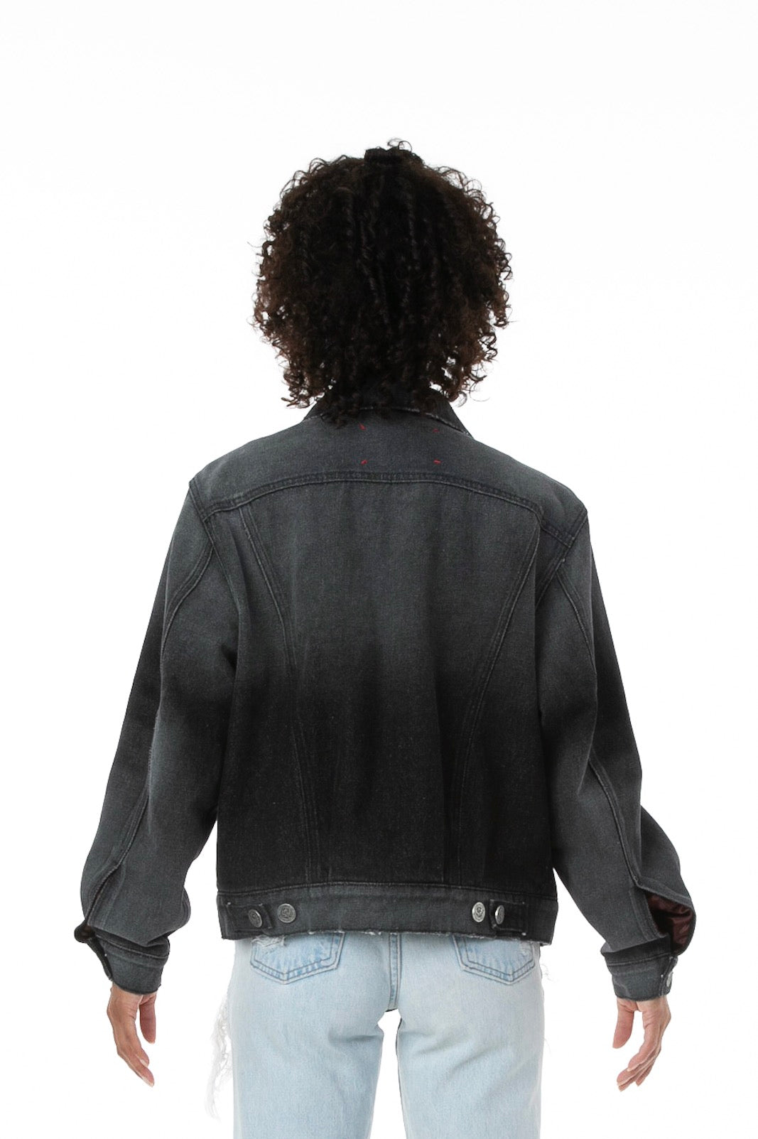 Backside of Female model wearing Black Truffle Denim jacket