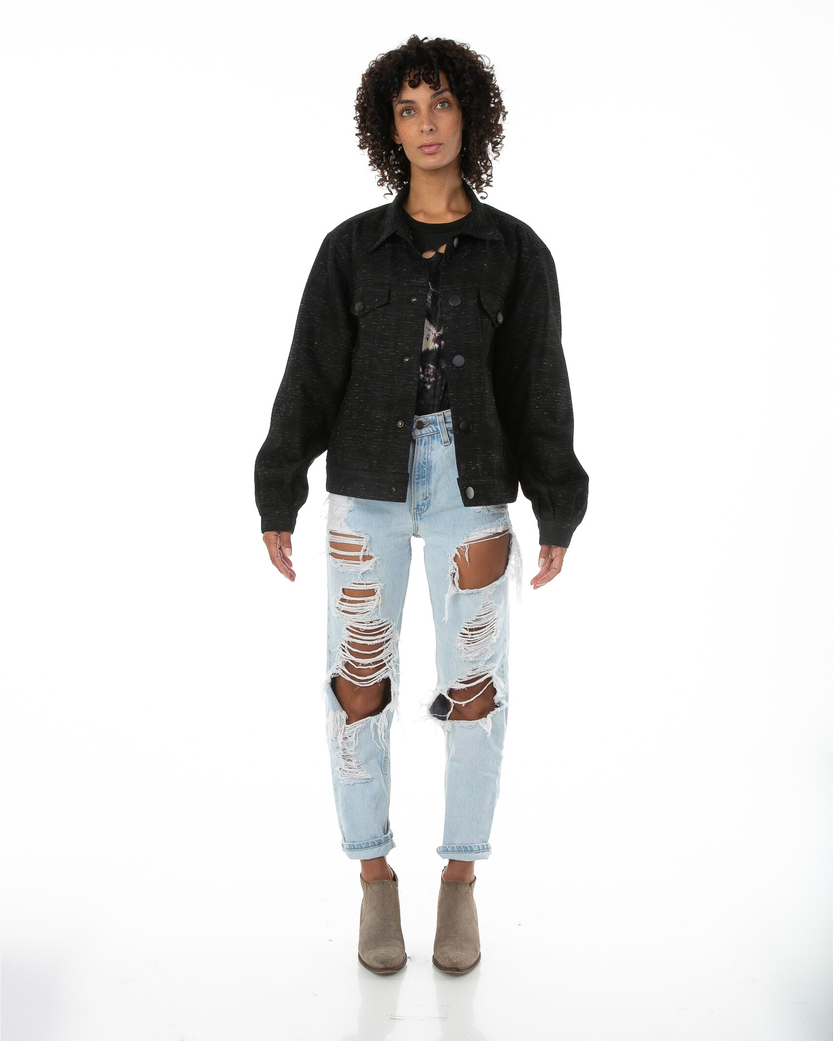 Front of female model wearing Reversible Parlor black denim jacket