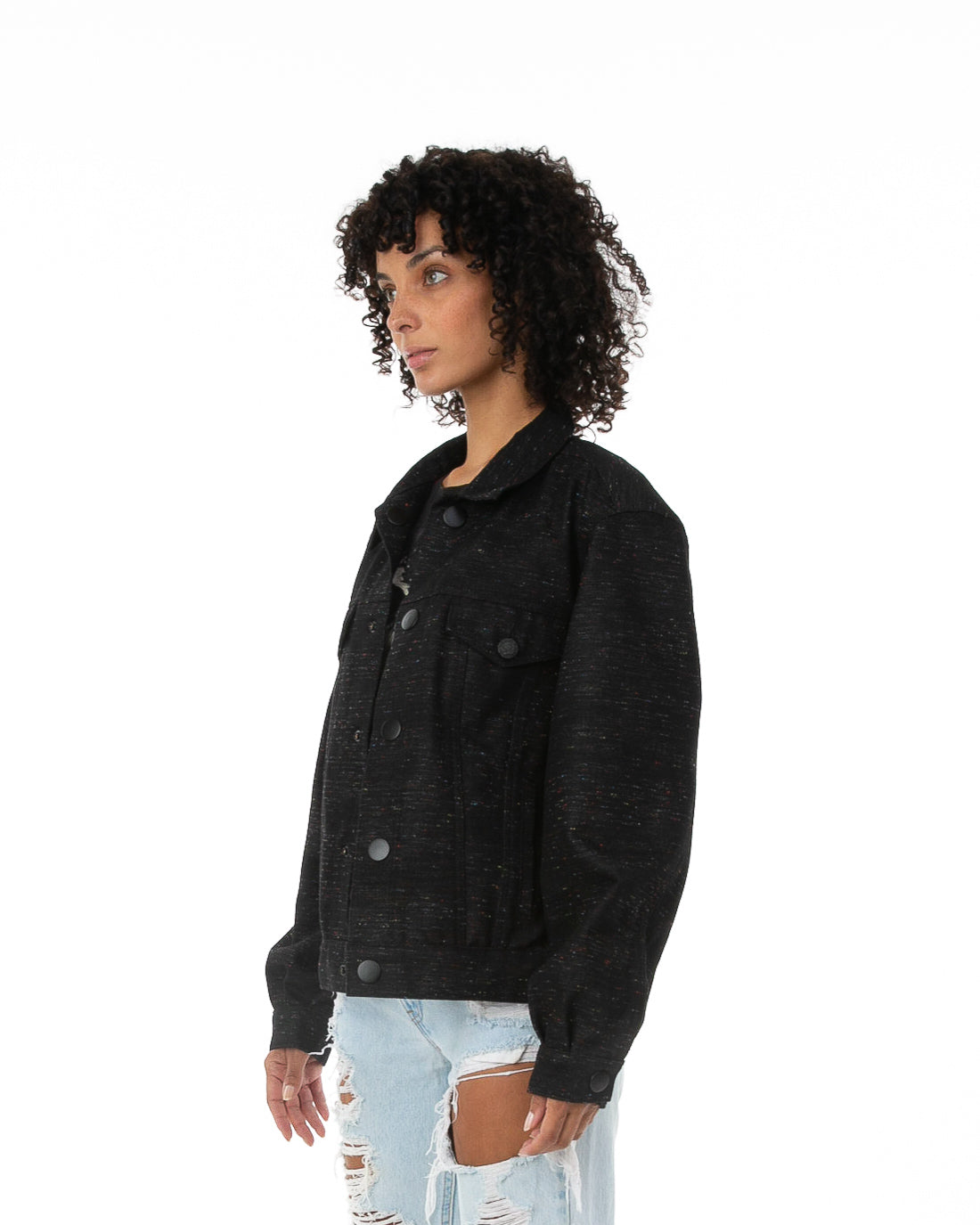 Side of female model wearing Reversible Parlor black denim jacket