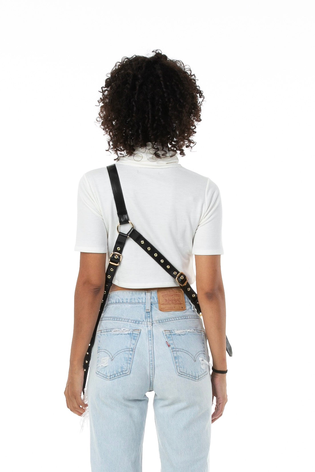 Backside of female model wearing Holster Bag in Black