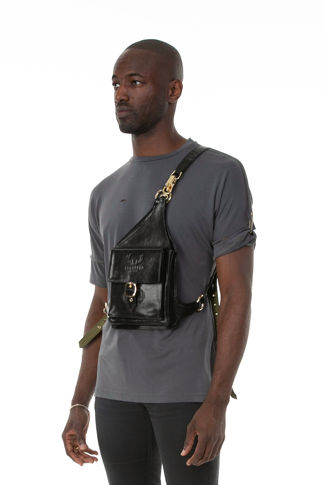 Side of male model wearing Holster Bag in Black
