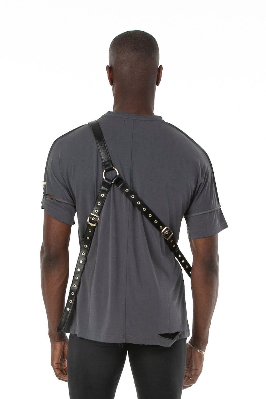 Backside of male model wearing Holster Bag in Black