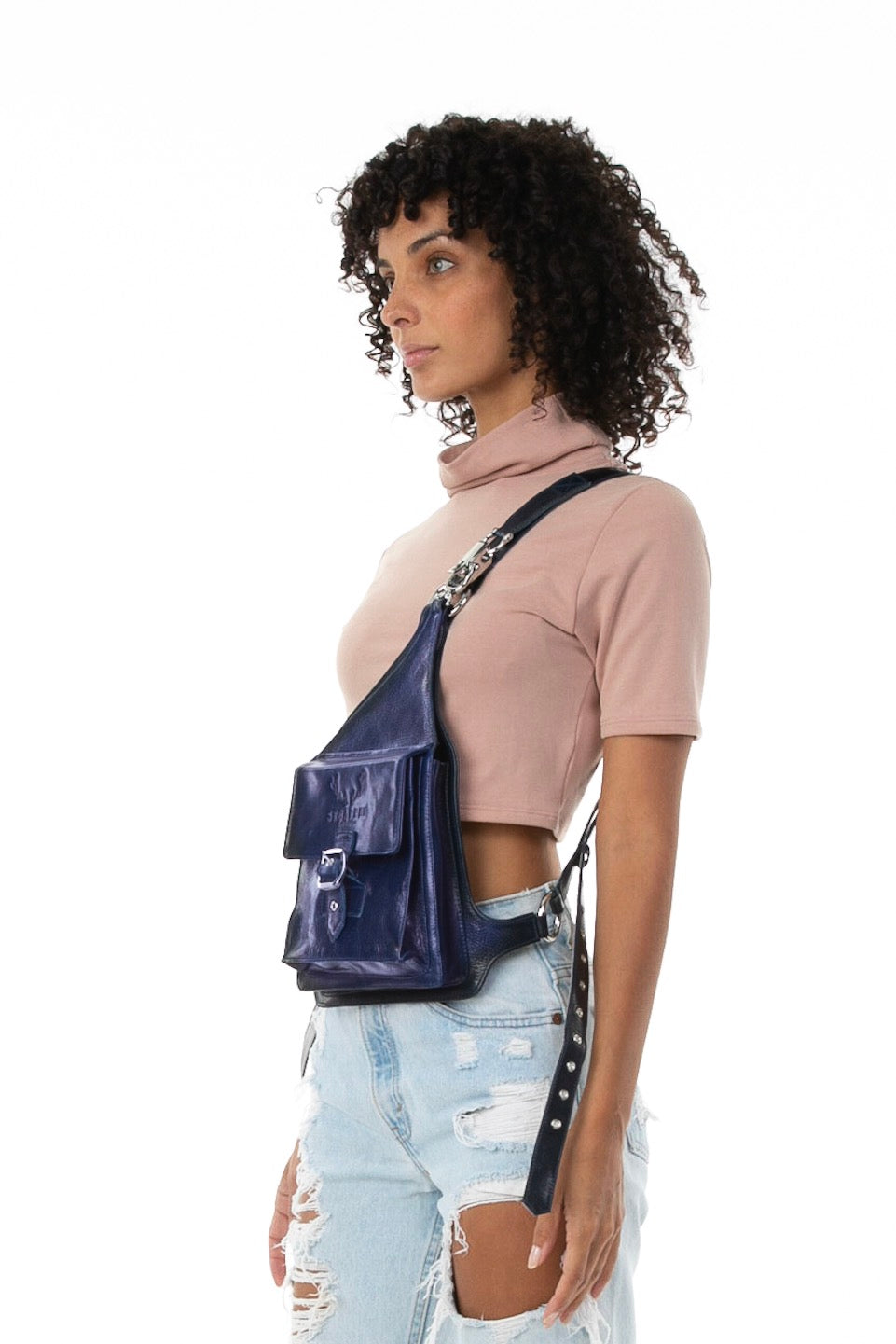 Side of female model wearing Holster Bag in Navy