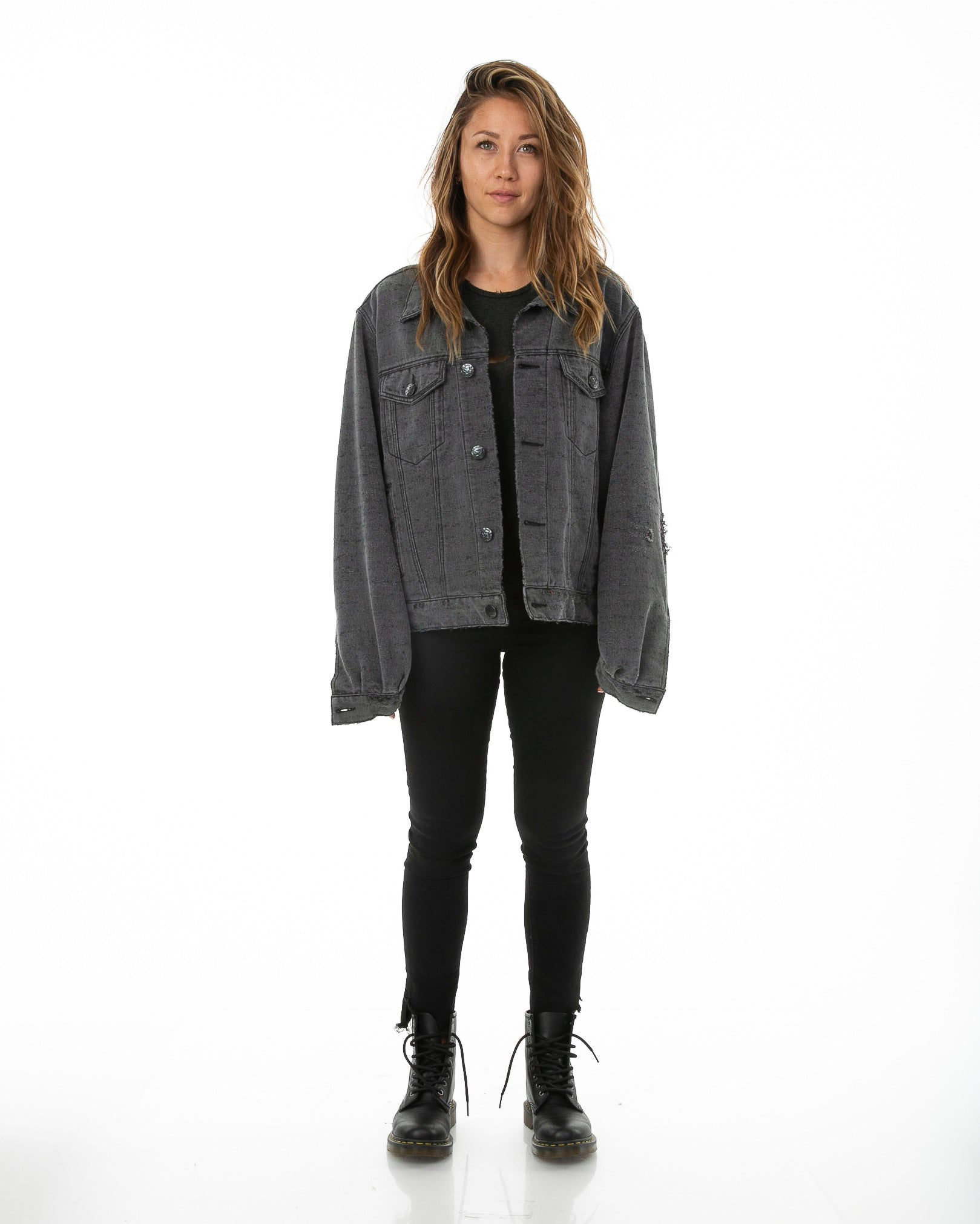 Front of female model wearing Midnight Denim jacket