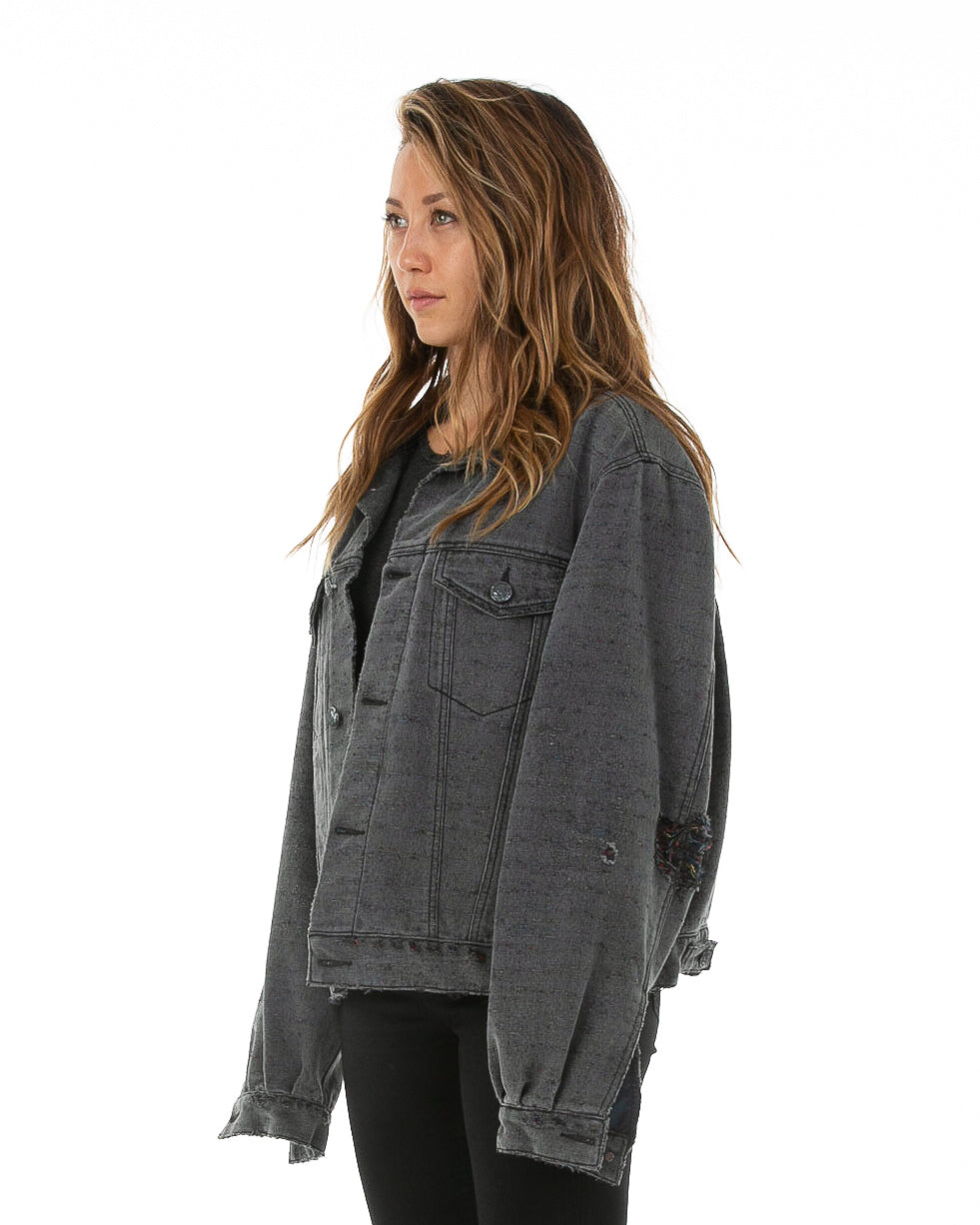 Side of female model wearing Midnight Denim jacket