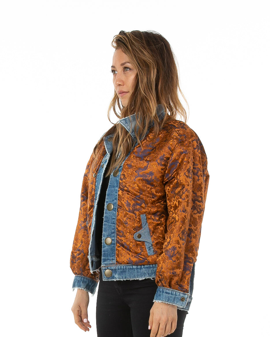 Side of female model wearing Dynasty Reversible Denim jacket
