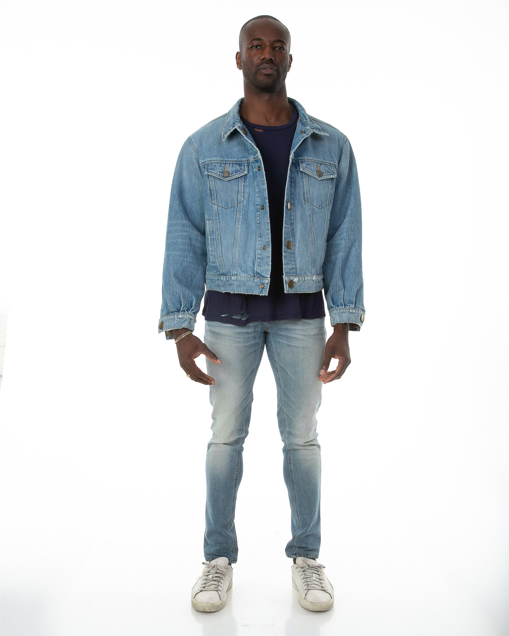 Front of male model wearing Dynasty Reversible Denim jacket