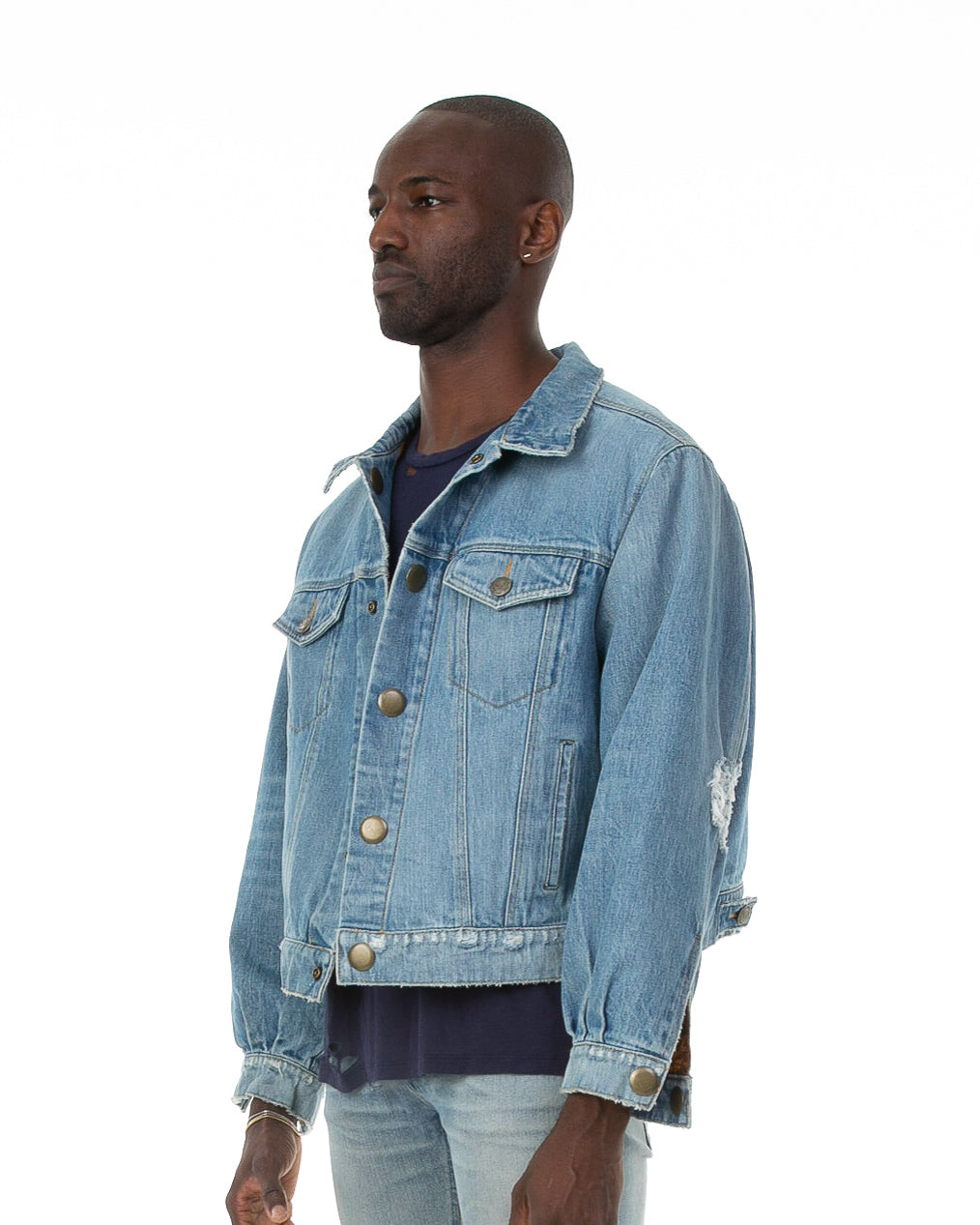 Side of male model wearing Dynasty Reversible Denim jacket