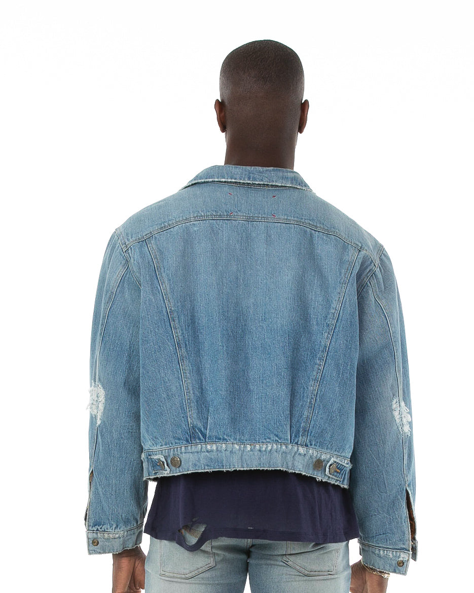 Backside of male model wearing Dynasty Reversible Denim jacket