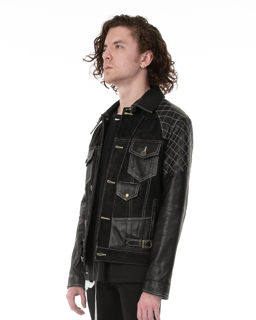 Side of male model wearing Emperor leather jacket