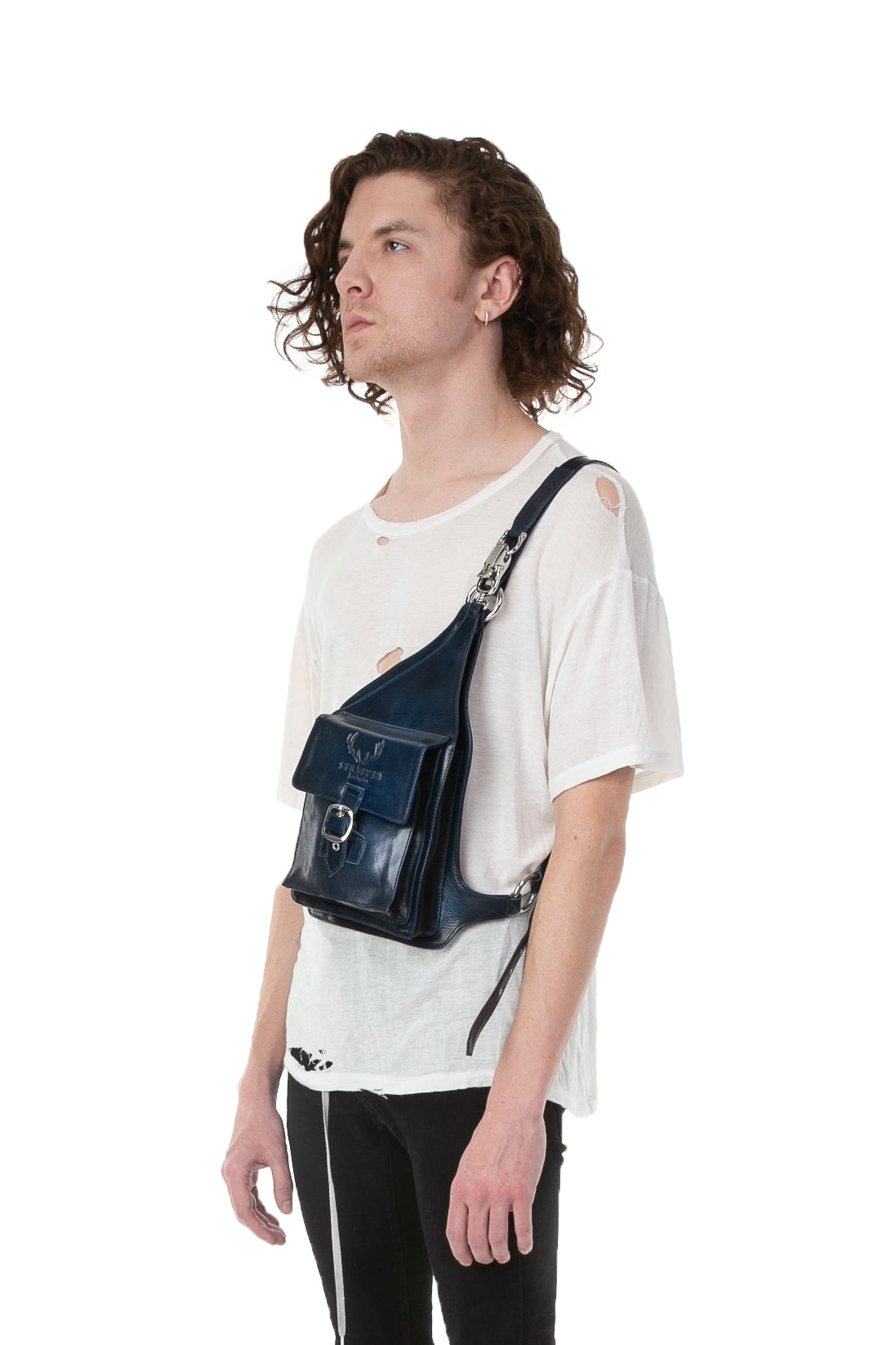 Side of male model wearing Holster Bag in Navy