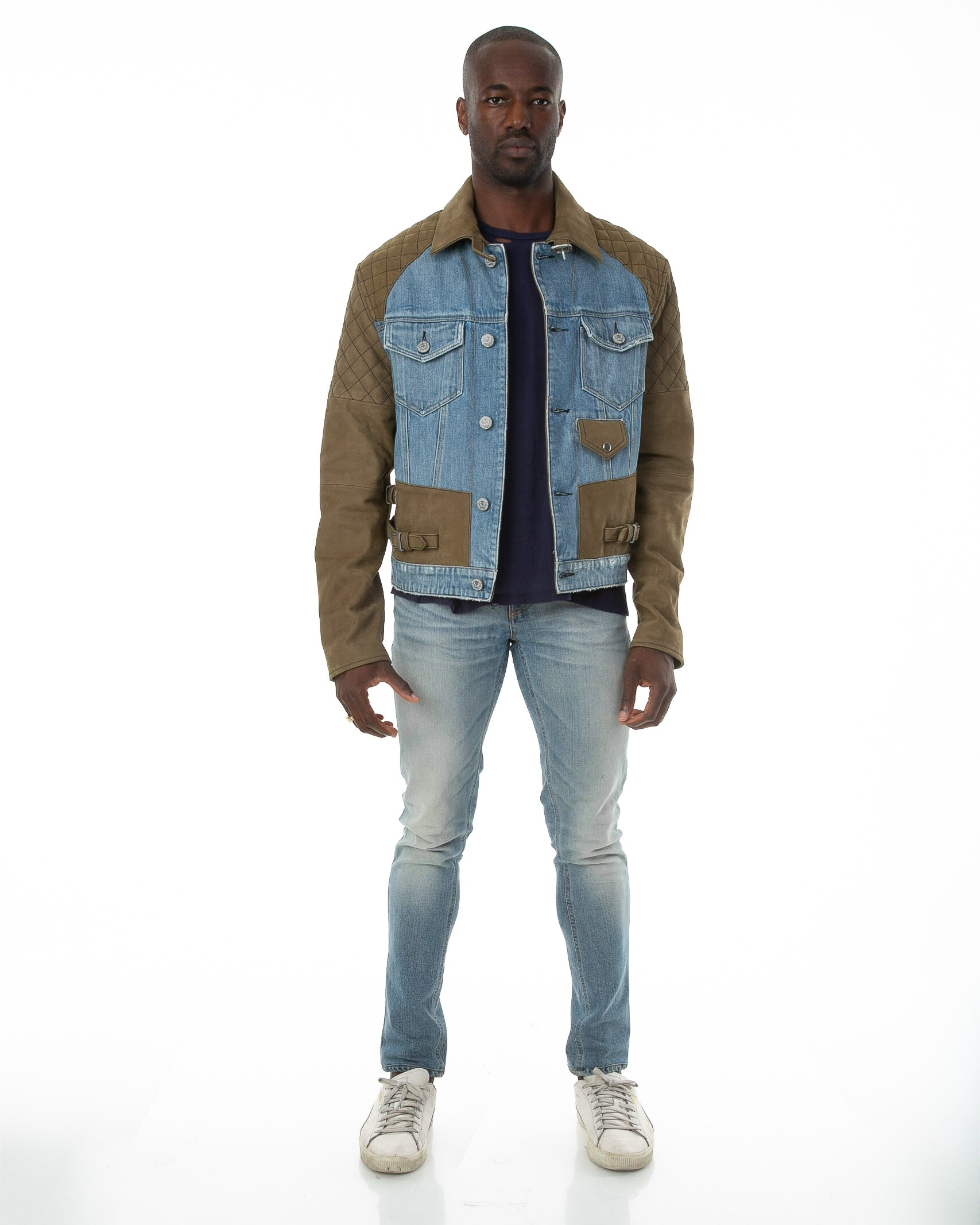 Front of male model wearing Tortuga leather and denim jacket