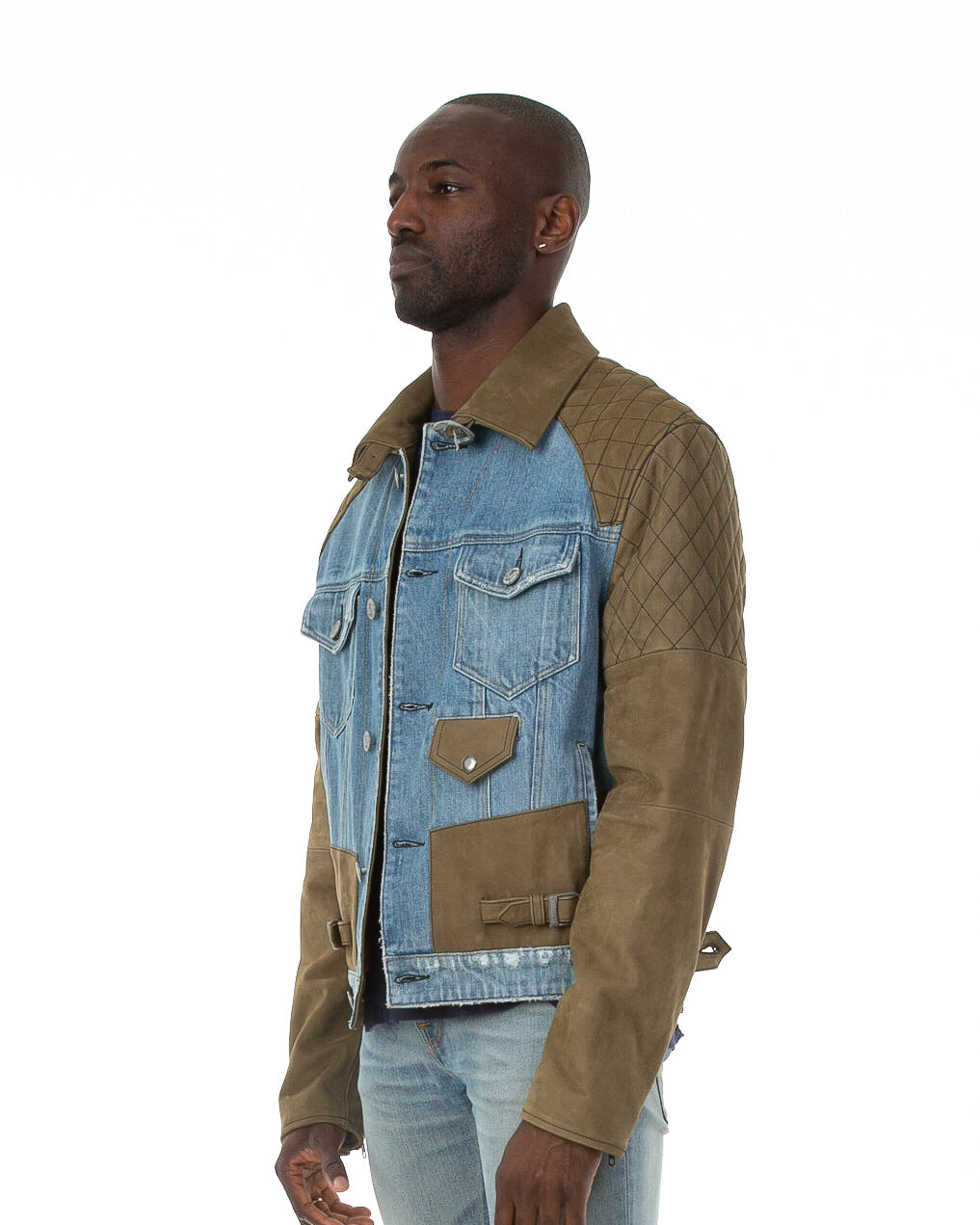 Side of male model wearing Tortuga leather and denim jacket