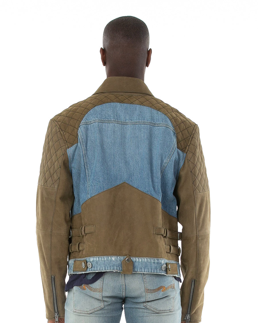 Backside of male model wearing Tortuga leather and denim jacket