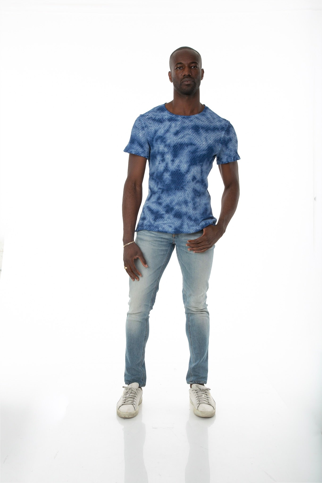 Front of male model wearing Pointelle Tee in Washed Blue