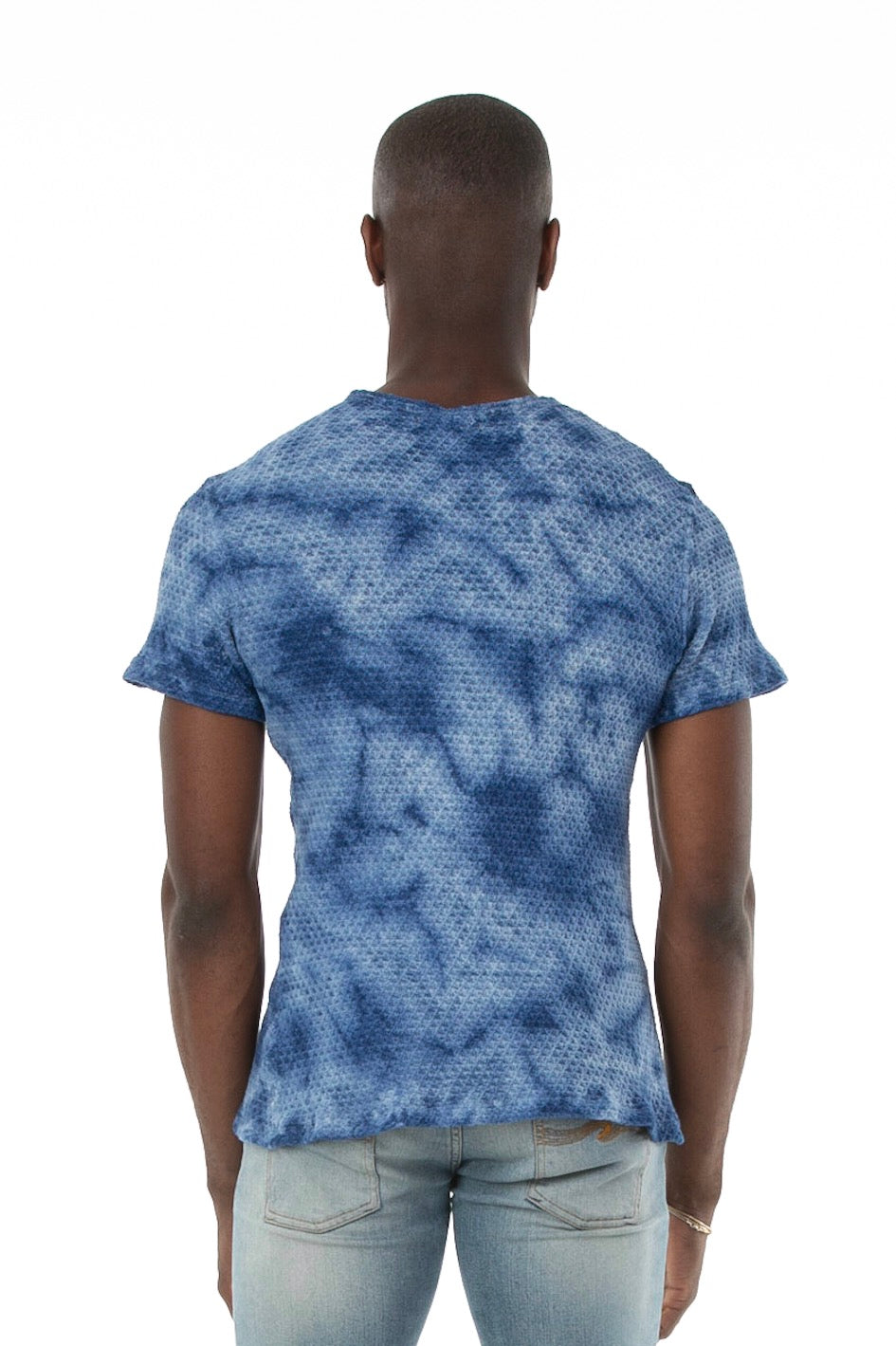 Back of male model wearing Pointelle Tee in Washed Blue