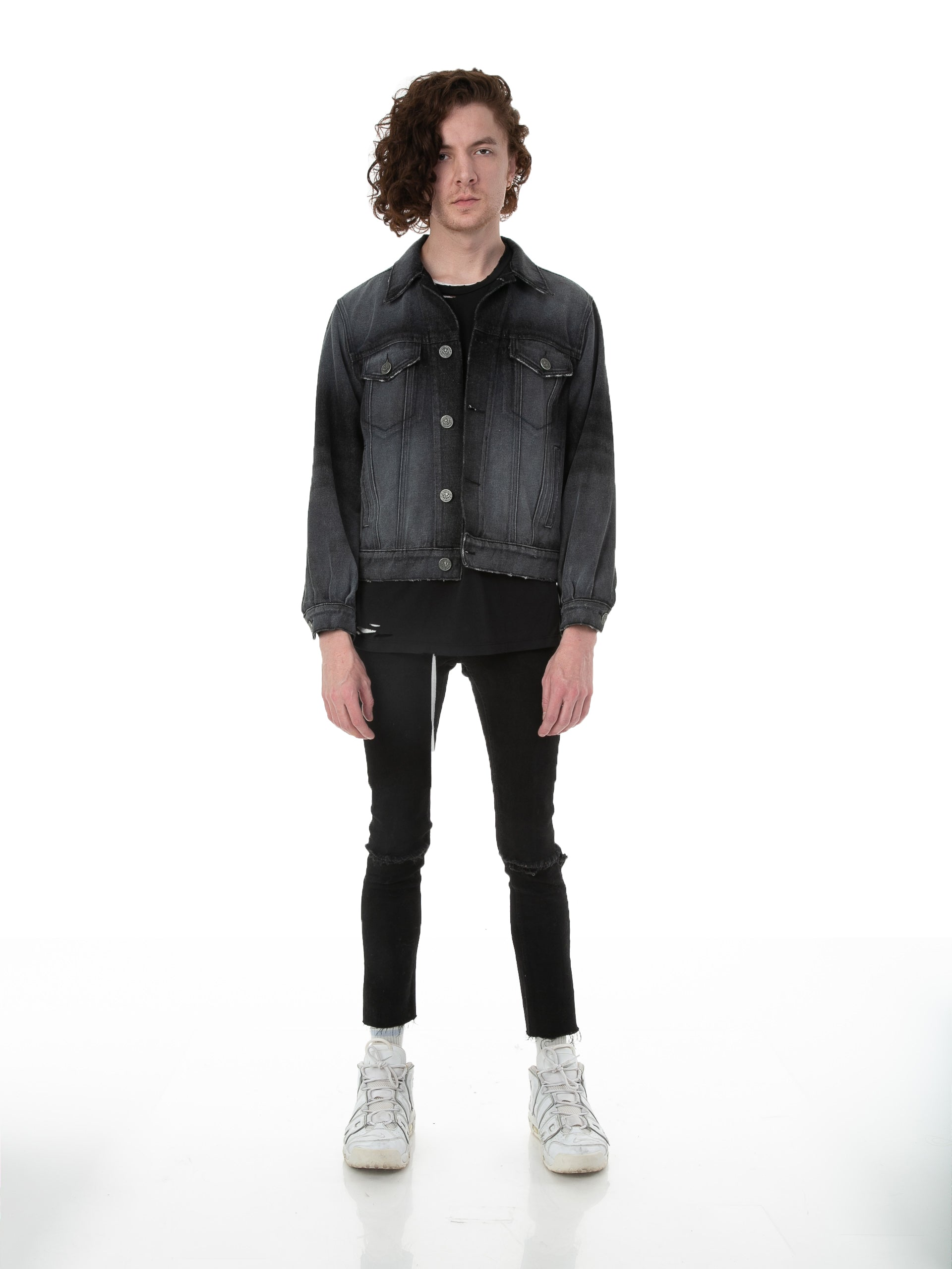 Front of male model wearing Black Truffle Denim jacket