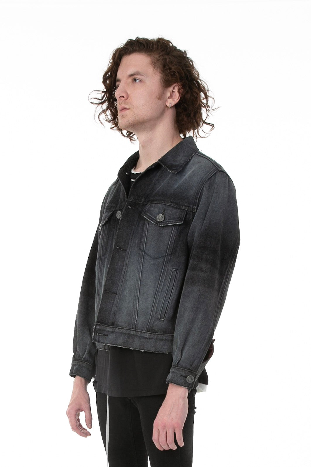 Side of male model wearing Black Truffle Denim jacket