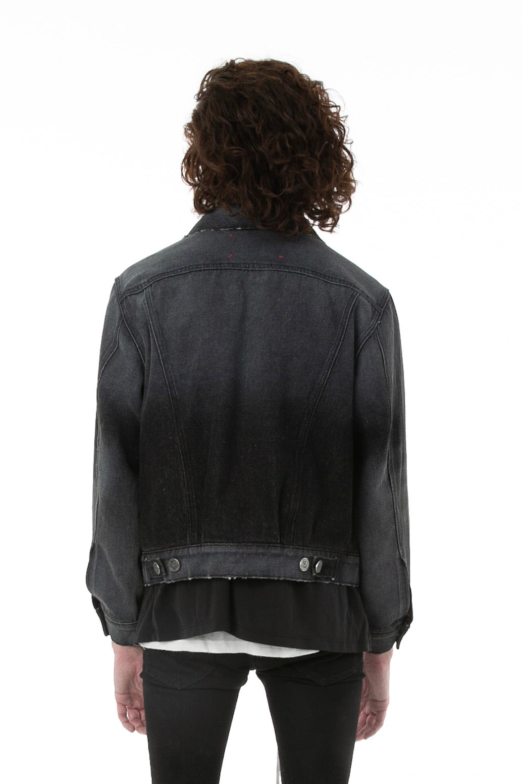 Backside of male model wearing Black Truffle Denim jacket