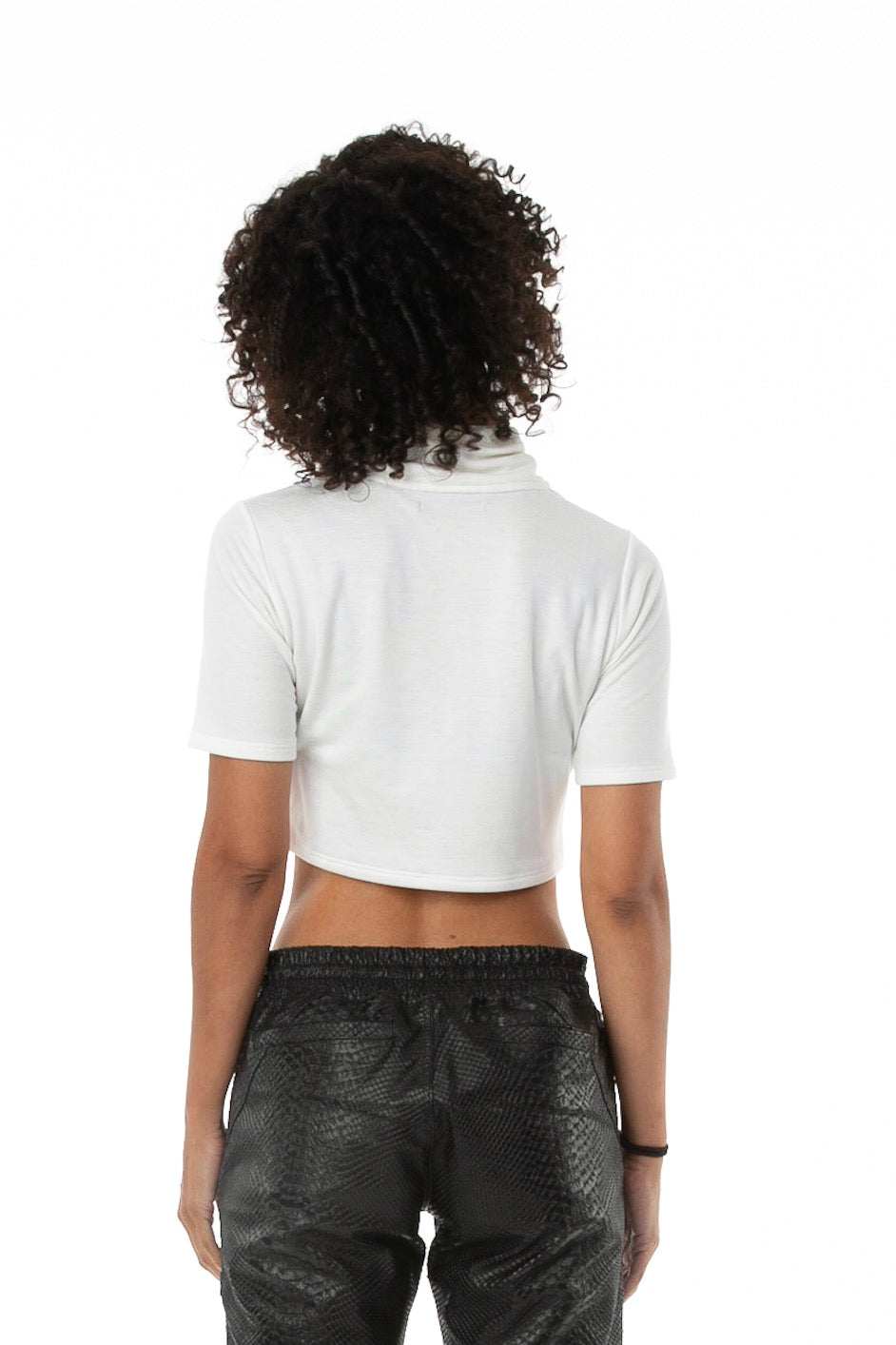 Back of female model wearing Mock Crop in Antique White