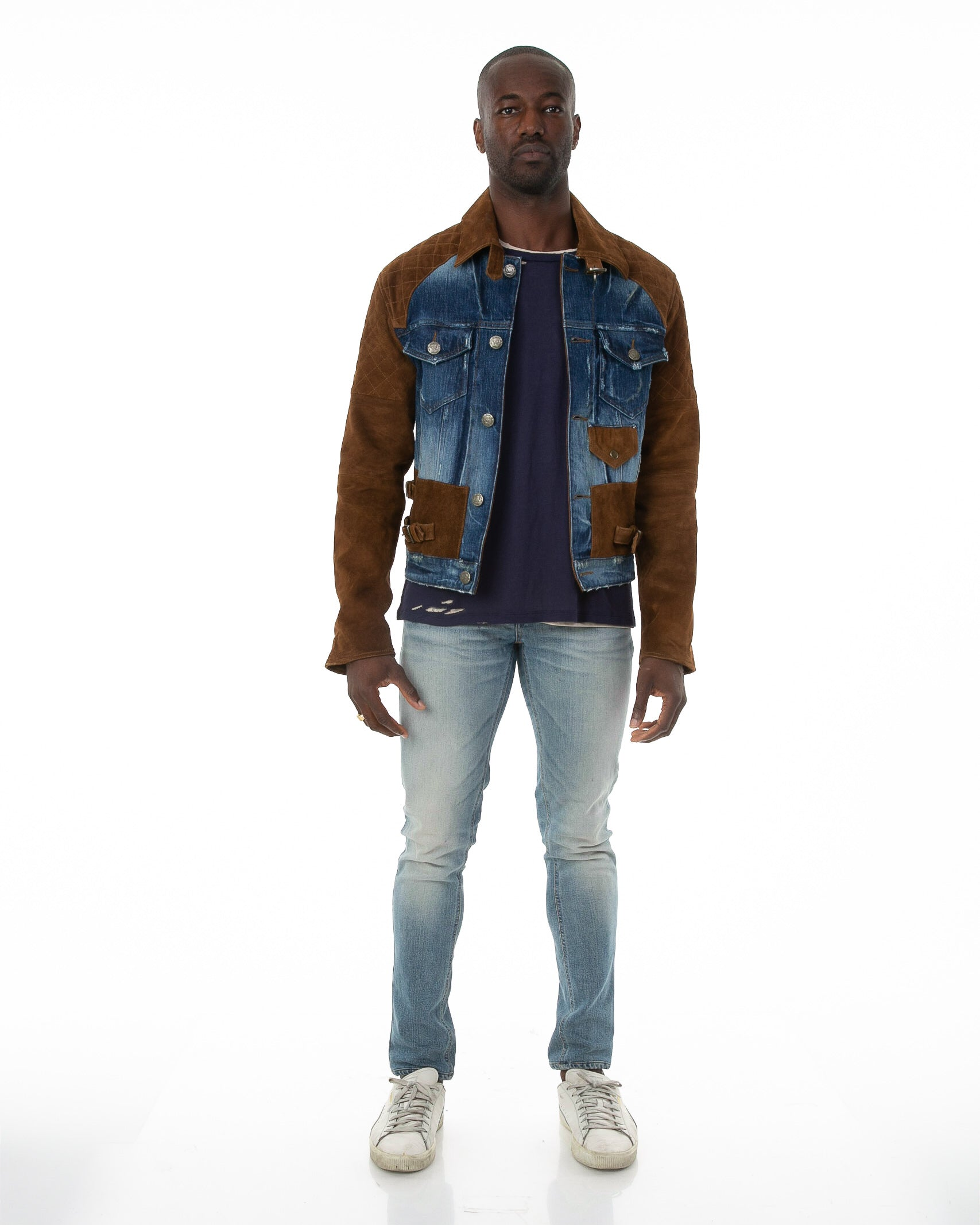 Front of male model wearing The Rider denim jacket