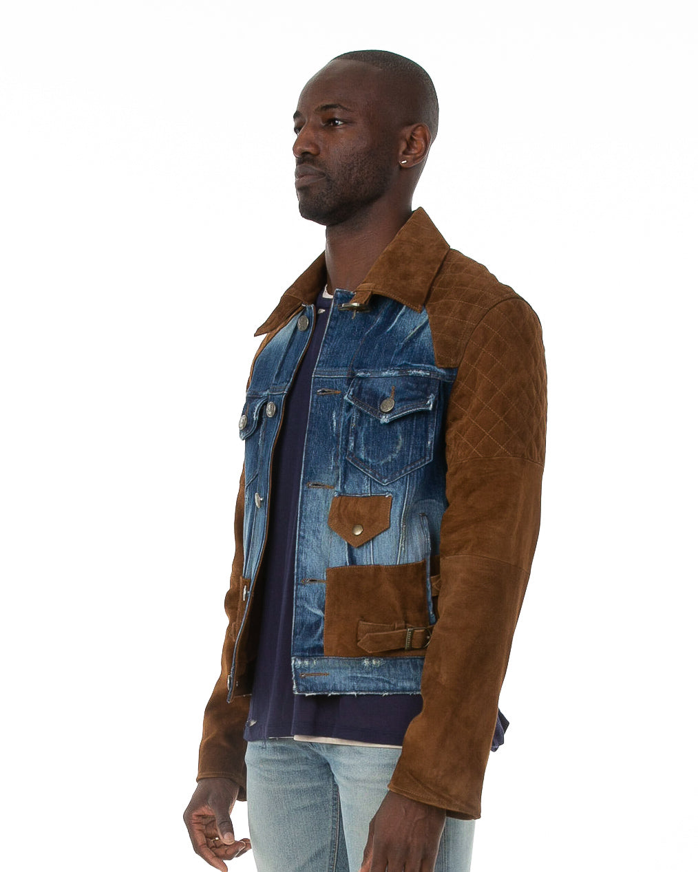 Side of male model wearing The Rider denim jacket