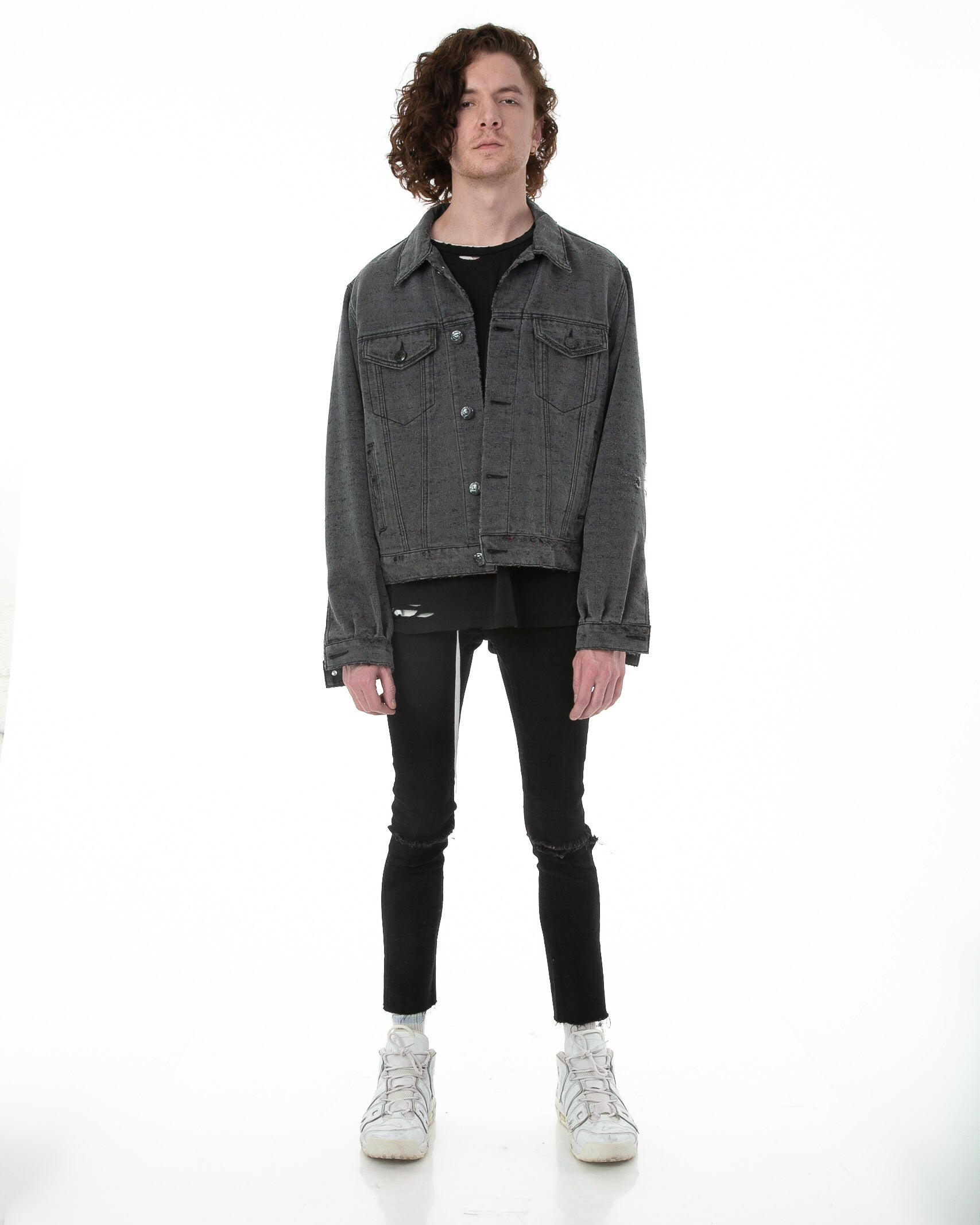 Front of male model wearing Midnight Denim jacket