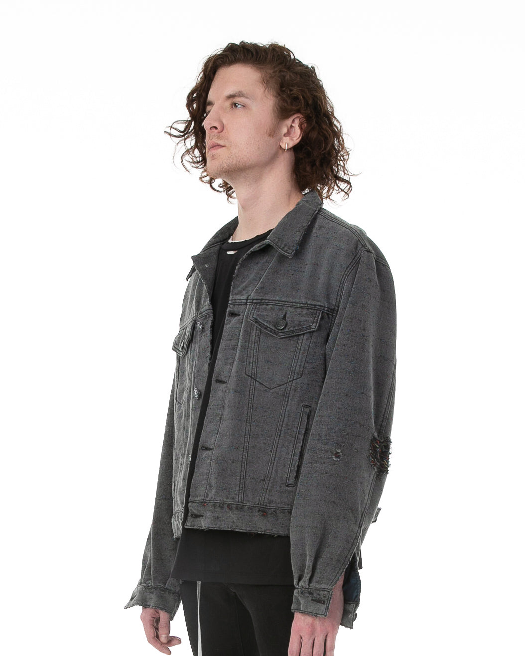 Side of male model wearing Midnight Denim jacket