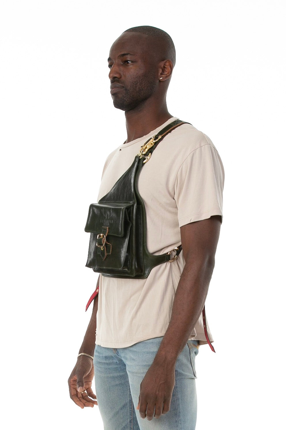 Side of male model wearing Holster Bag in Green